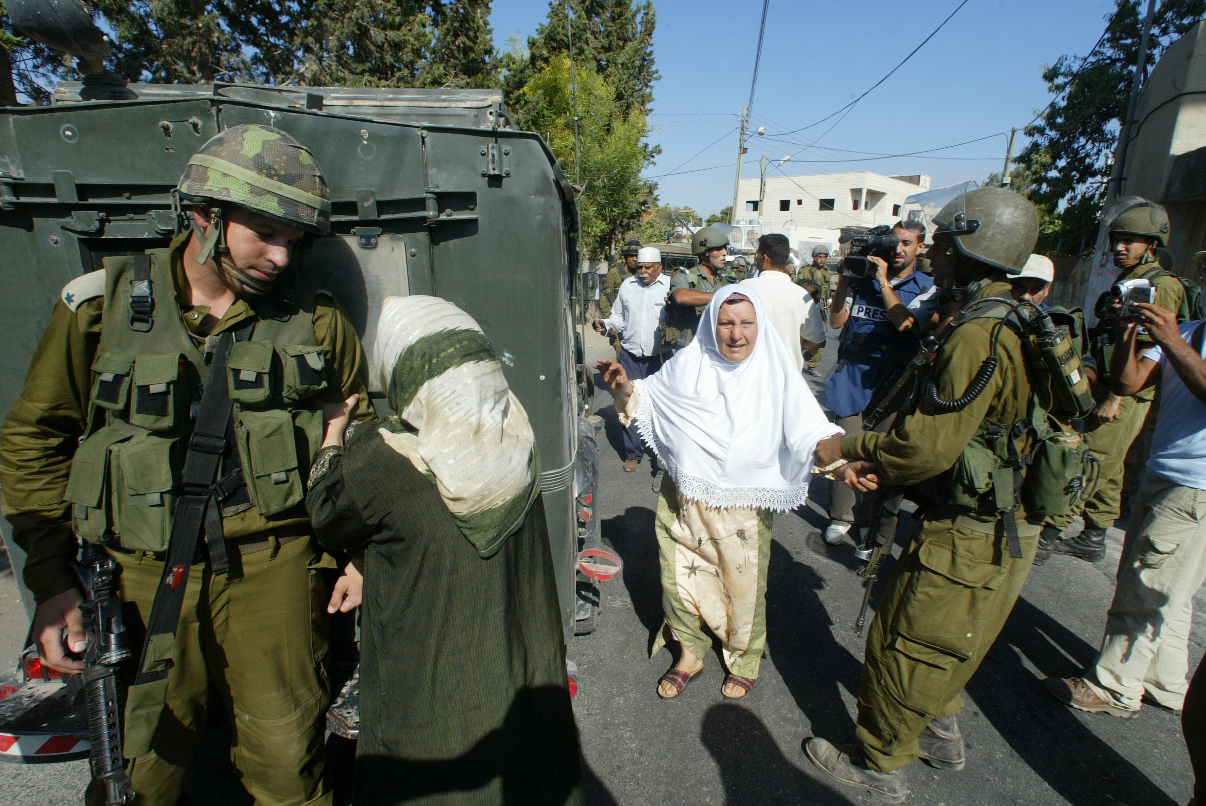 Still from 5 Broken Cameras. Scene shows the mother of a young man arrested by Israeli soldiers.